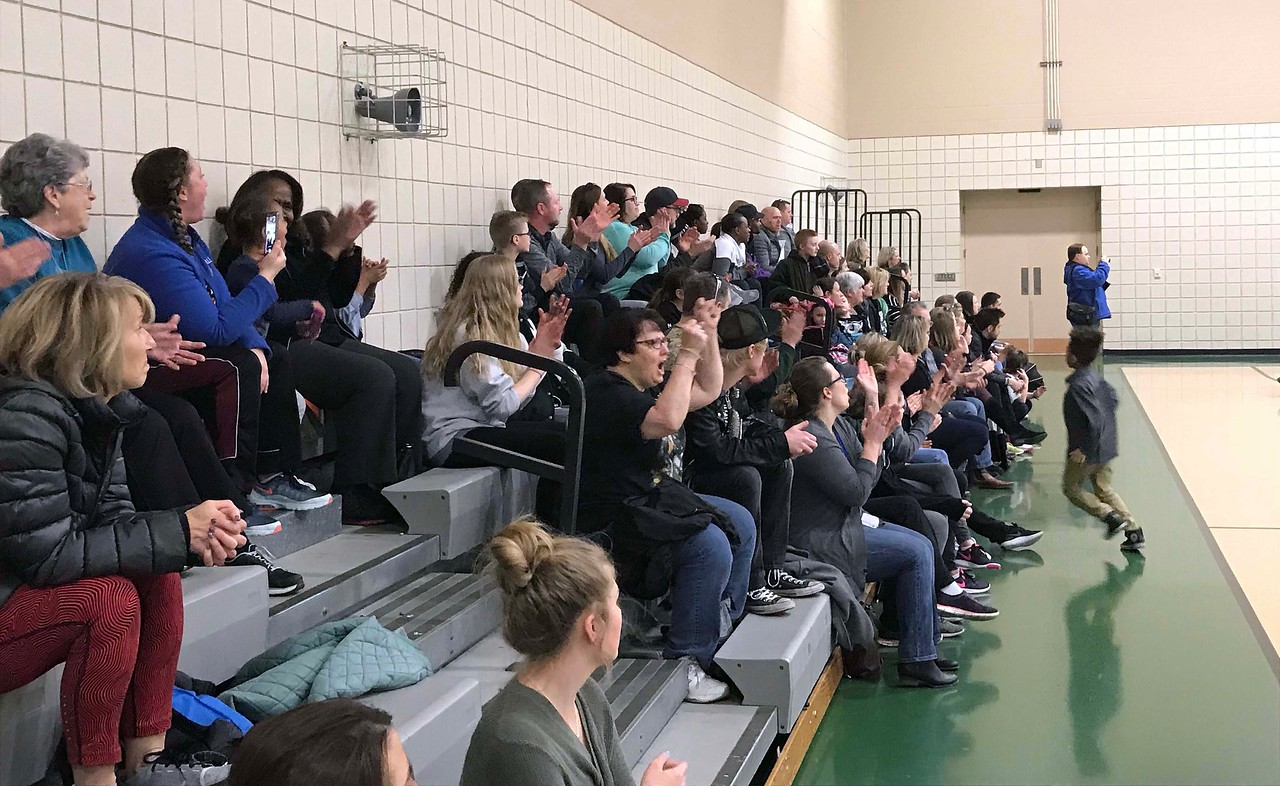 NATHAN HAVENNER / GAZETTE  Family members cheer on fifth-graders participating Thursday in the Medina County Police Activities League March Madness Basketball Tournament at Medina Community Recreation Center