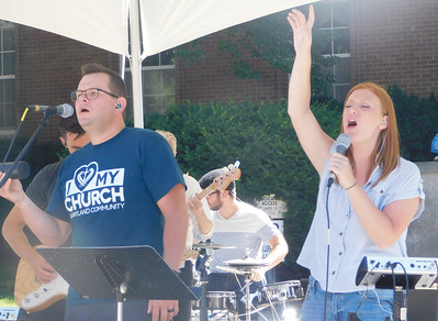 A crowd of about 2,000 people gathered to watch baptisms on Medina Public Square. JONATHAN DELOZIER / GAZETTE
