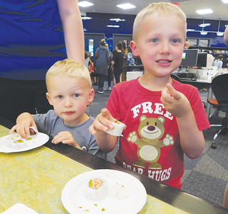 Grantlin and Grayson Baugh, of Valley City, try some sushi made fresh Tuesday during Family Food Fest at Buckeye Library in York Township. JONATHAN DELOZIER / GAZETTE
