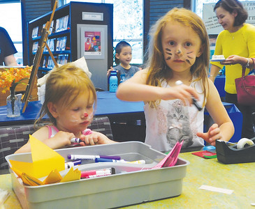 Charlotte and Abby D'Amico, of Valley City, craft food-themed bookmarks Tuesday during Family Food Fest at Buckeye Library in York Township. JONATHAN DELOZIER / GAZETTE