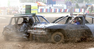 Demolition Derby driver Matt Segedi (L) of Medina is hit by Randy Hahn during their heat at the Medina County Fair. Aaron Josefczyk/Gazette