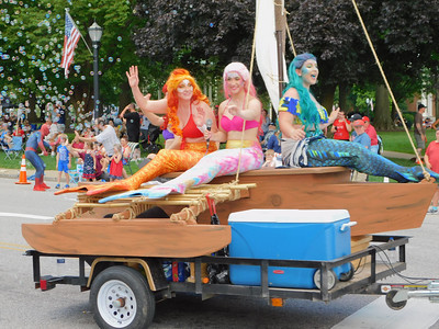 BOB FINNAN / GAZETTE These mermaids probably needed to be hosed off Thursday in the 90-degree heat during the Medina Fourth of July Parade.