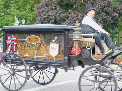 BOB FINNAN / GAZETTE An 1800s hearse from Waite & Sons Funeral Home was in the Medina Fourth of July Parade Thursday on Public Square.
