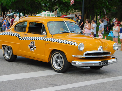 BOB FINNAN / GAZETTE This yellow cab seemed out of place in Medina's Fourth of July parade Thursday.