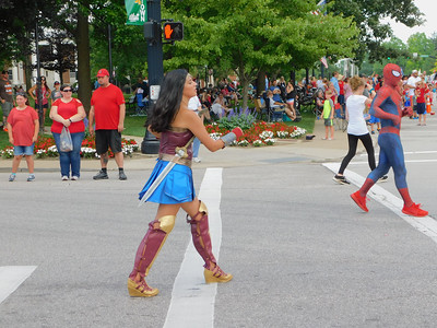 BOB FINNAN / GAZETTE Some superheroes made their way on Public Square Thursday, including Wonder Woman, left, and Spiderman during the Medina Fourth of July Parade.