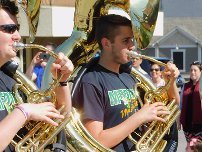BOB FINNAN / GAZETTE The brass section of the Medina Musical Bees, including the tubas, march in the Memorial Day parade Monday in Medina.