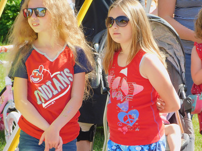 BOB FINNAN / GAZETTE Girls watch the Medina's Memorial Day parade Monday on East Liberty Street.