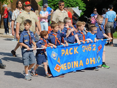 BOB FINNAN / GAZETTE Cub Scout Pack 3462, of Medina, marches in Medina's Memorial Day parade Monday.