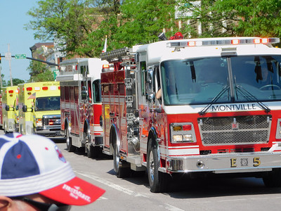 BOB FINNAN / GAZETTE Fire trucks are lined up as far as one can see on Liberty Street during Medina's Memorial Day parade Monday.
