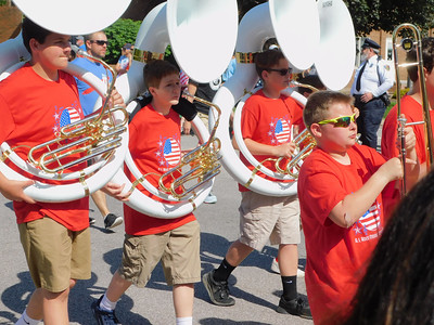 BOB FINNAN / GAZETTE The tuba players from A.I. Root Middle School march in Medina's Memorial Day parade Monday.