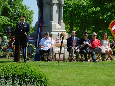 BOB FINNAN / GAZETTE Maj. Andy Hascher, left, U.S. Army foreign area officer, speaks to the crowd assembled at Spring Grove Cemetery on Monday. Next to him is U.S. Army veteran Ray Hewitt; Harvest Presbyterian Church Rev. David Wallover; U.S. Army veteran Cal Bias; Medina Mayor Dennis Hanwell and Claire Schmeller, a 2019 Medina High School graduate.