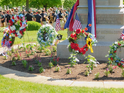 BOB FINNAN / GAZETTE Wreaths are placed at the foot of a monument Spring Grove Cemetery on Monday