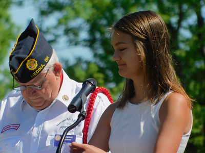 "BOB FINNAN / GAZETTE Claire Schmeller, a 2019 graduate of Medina High School, at Spring Grove Cemetery delivers a rendition of the ""Gettysburg Address."""