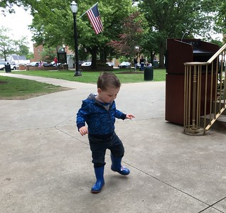 Russell Bengough Jr., 2, of Medina, spins to the music of Blue Groove on Saturday. He was there with mom Colleen and dad Russell Sr. along with brother Robin, 1.  BOB SANDRICK / GAZETTE