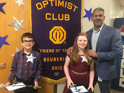 ALYSSA ALFANO / GAZETTE Gideon Kortan and Isabelle Heignbaugh-McCroskey, fifth-graders at Brunwick's Huntington Elementary School, posed with Principal Kesh Boodheshwar after receiving their awards Wednesday at the Brunswick Optimist Club's annual Respect for Law and Youth Appreciation Day event.