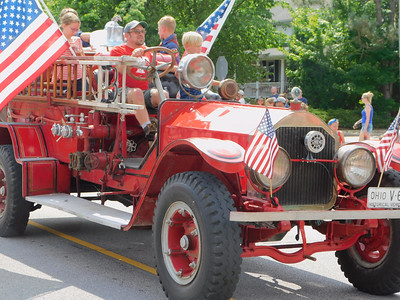 BOB FINNAN / GAZETTE Kids love fire trucks. Here, one drives in the Valley City Fourth of July parade Thursday down state Route 303.