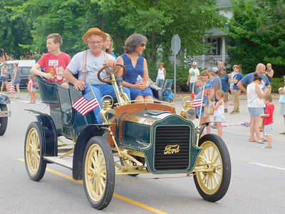 BOB FINNAN / GAZETTE Paul Schaefer, driving, and his 1906 Ford won best of show in the Valley City Antique and Classic Cars show Thursday. He is a trustee in Valley City.