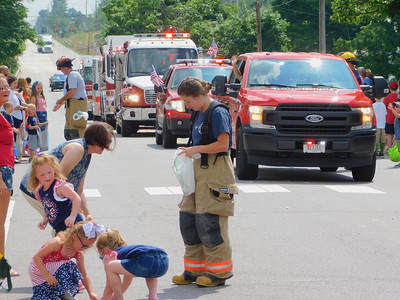 BOB FINNAN / GAZETTE Valley City Firefighters hand out candy to children Thursday during the Valley City parade down state Route 303.