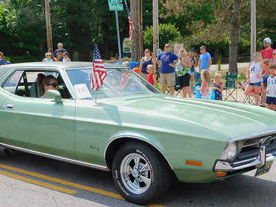 BOB FINNAN / GAZETTE This green Mustang was in the Valley City Fourth of July parade Thursday down state Route 303.
