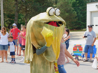 BOB FINNAN / GAZETTE Valley City is doing some cross promotion. The Valley City Frog Jump Festival is Aug. 18. Here, the frog is just relaxing in the Fourth of July parade Thursday.