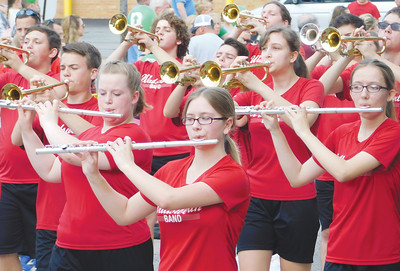JONATHAN DELOZIER / GAZETTE The Wadsworth High School Marching Band provides musical accompaniment. A two-mile parade with more than 100 entries officially began Wadsworth's 46th annual Blue Tip Festival on Tuesday.