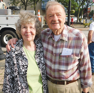 JONATHAN DELOZIER / GAZETTE  Marian and Virgil Mochel take in the moment Tuesday after Marian served as grand marshal for the Blue Tip parade and was honored for her 50 years of service.