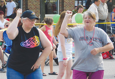 JONATHAN DELOZIER / GAZETTE Vickie Harris of Wadsworth and Turtledove Braun of Fostoria put on their dancing shoes. A two-mile parade with more than 100 entries officially began Wadsworth's 46th annual Blue Tip Festival on Tuesday.