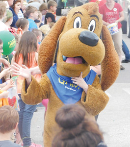 JONATHAN DELOZIER / GAZETTE Gravy the Dog hands out high-fives. A two-mile parade with more than 100 entries officially began Wadsworth's 46th annual Blue Tip Festival on Tuesday.