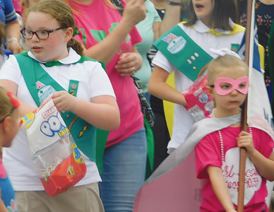 JONATHAN DELOZIER / GAZETTE Girl Scouts show their Wadsworth spirit. A two-mile parade with more than 100 entries officially began Wadsworth's 46th annual Blue Tip Festival on Tuesday.