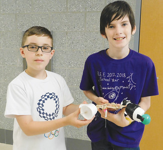 "JONATHAN DELOZIER / GAZETTE Wadsworth seventh-grader Elijah Raines and Barberton sixth-grader Lucas Holloway show off a gripping arm they created and dubbed ""The Beast"" at Wadsworth High School during STEM Summer Camp."