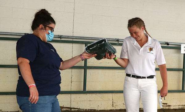 Kylie Weaver accepts a blanket for her 10 years in dairy club Friday at the Elkhart County 4-H Fairgrounds.
