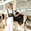 Ten-year 4-H'er Amy Thomas poses with one of her dairy cows Friday at the Elkhart County 4-H Fairgrounds.