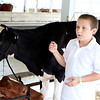 Aiden Ritchie, 9, Middlebury, talks about showing his heifers at the Elkhart County 4-H Fairgrounds Friday.