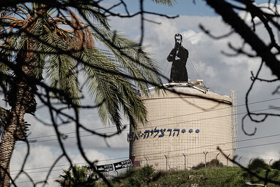 A sculpture of Theadore Herzl atop a water reservoir stands at the Sira Junction at an entrance to the city of Herzliya, named after the father of modern political Zionism.