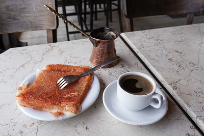 A traditional serving of knafeh nabulsiyeh and Arabic coffee is served in a restaurant in the village of Abu Ghosh, outside Jerusalem, Israel.