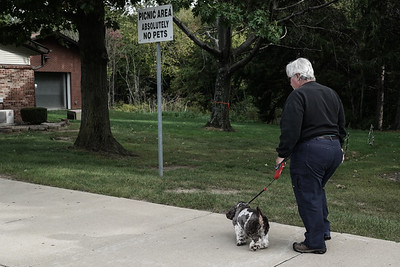A man walks a dog past a sign prohibiting pets at a rest stop along I-79 in north west Pennsylvania.