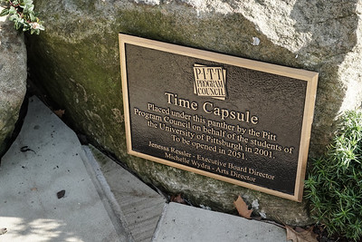 A plaque designates the location of a time capsule buried in 2001 by the Pitt Program Council on behalf of the students of the University of Pittsburgh, to be opened in 2051.