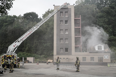 Firefighters train at the Pittsburgh Police and Fire Training Center.