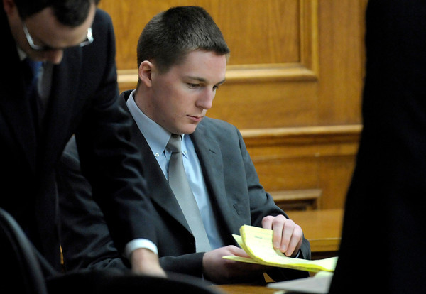 Kevin McGregor looks through his trial note before the start of jury instructions and closing argument before his case goes to the jury at the Boulder County Justice Center  in Boulder, Colorado February 1, 2012.  CAMERA/MARK LEFFINGWELL