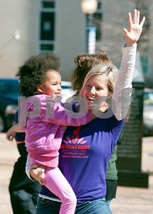 """photo by Sarah A. Miller/Tyler Morning Telegraph  Annie Moch of Tyler dances with Sasha Wando, 3, during One Billion Rising, a national fun protest against women's violence that was held on the square in downtown Tyler Thursday afternoon. The name One Billion Rising comes from the statistic from the 2003 UNIFEM report entitled """"Not A Minute More: Ending Violence Against Women"""" that one in three women on the planet will be raped or beaten in her lifetime. The movement aims to quell the acceptance against rape and violence to women globally."""