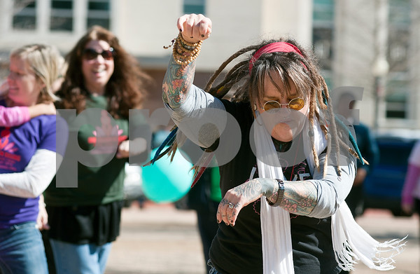 """photo by Sarah A. Miller/Tyler Morning Telegraph  Jackie McDonald of Jacksonville dances during One Billion Rising, a national fun protest against women's violence that was held on the square in downtown Tyler Thursday afternoon. The name One Billion Rising comes from the statistic from the 2003 UNIFEM report entitled """"Not A Minute More: Ending Violence Against Women"""" that one in three women on the planet will be raped or beaten in her lifetime. The movement aims to quell the acceptance against rape and violence to women globally."""