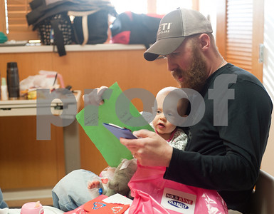 photo by Sarah A. Miller/Tyler Morning Telegraph  Justin Tutt of Tyler reads a homemade Valentine's Day card to his daughter Reese, 1, while they spent the day at the East Texas Medical Center hospital in Tyler Friday for the baby's peanut butter allergy. 89.5 KVNE &91.3 KGLY's radio personalities and volunteers delivered homemade Valentines with notes of encouragement made by East Texas families, schools, churches, and individuals to hospitals and nursing homes all over East Texas Friday, February 14th.