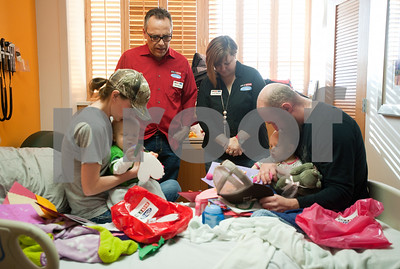 photo by Sarah A. Miller/Tyler Morning Telegraph  Mike Harper and Carrie Parsons of radio stations KVNE and KGLY pray over the Tutt family after giving them Valentine's Day cards while they spent the day at the East Texas Medical Center hospital in Tyler Friday. Pictured are Haley Tutt, twins Lawson and Reese Tutt, 1,   and Justin Tutt of Tyler. Reese was hospitalized for a peanut butter allergy. 89.5 KVNE &91.3 KGLY's radio personalities and volunteers delivered homemade Valentines with notes of encouragement made by East Texas families, schools, churches, and individuals to hospitals and nursing homes all over East Texas Friday, February 14th.