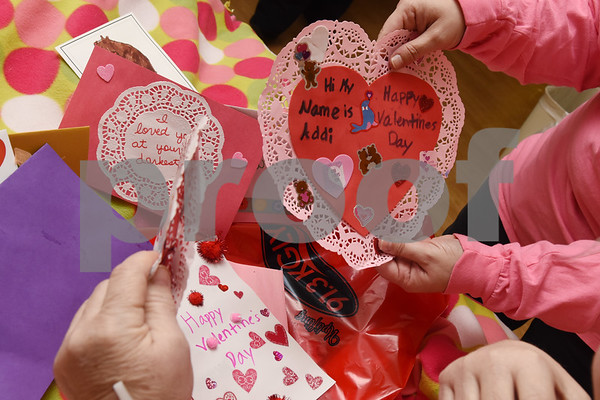 Carrie Parsons helps Rebecca Evans look through  a bag of Valentine's Day cards from radio stations 89.5 KVNE and 91.3 KGLY Tuesday Feb. 14, 2017 at East Texas Medical Center in Tyler. The radio station handed out handmade Valentine's Day cards to residents at local hospitals and assisted living facilities on Valentine's Day.  (Sarah A. Miller/Tyler Morning Telegraph)
