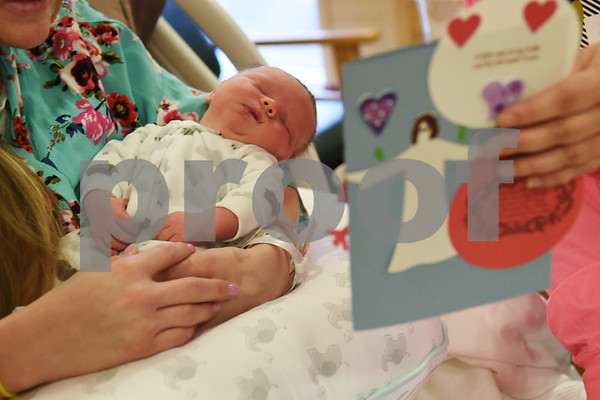 Jennifer Archbell of Chandler and her newborn son Grayson receive a bag of Valentine's Day cards from radio stations 89.5 KVNE and 91.3 KGLY Tuesday Feb. 14, 2017 at East Texas Medical Center in Tyler. The radio station handed out handmade Valentine's Day cards to residents at local hospitals and assisted living facilities on Valentine's Day.  (Sarah A. Miller/Tyler Morning Telegraph)