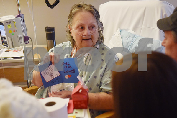 Betty Herd of Cedar Creek Lake receives a bag of Valentine's Day cards from radio stations 89.5 KVNE and 91.3 KGLY Tuesday Feb. 14, 2017 at East Texas Medical Center in Tyler. The radio station handed out handmade Valentine's Day cards to residents at local hospitals and assisted living facilities on Valentine's Day.  (Sarah A. Miller/Tyler Morning Telegraph)