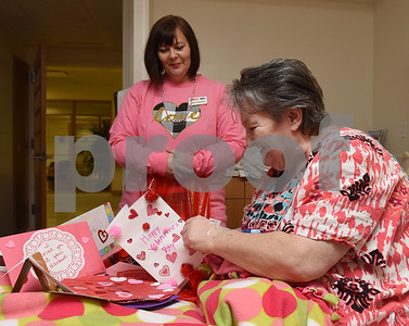 Carrie Parsons watches as Rebecca Evans looks through  a bag of Valentine's Day cards from radio stations 89.5 KVNE and 91.3 KGLY Tuesday Feb. 14, 2017 at East Texas Medical Center in Tyler. The radio station handed out handmade Valentine's Day cards to residents at local hospitals and assisted living facilities on Valentine's Day.  (Sarah A. Miller/Tyler Morning Telegraph)