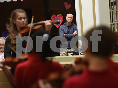 Brad Clontz attends a concert at Park Place Nursing & Rehabilitation Center Tuesday Feb. 14, 2017. Violin students from St. Gregory Cathedral School played music during lunch.  (Sarah A. Miller/Tyler Morning Telegraph)