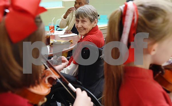 Resident Rhebe Myers listens as violin students from St. Gregory Cathedral School play music during lunch at Park Place Nursing & Rehabilitation Center Tuesday Feb. 14, 2017.  (Sarah A. Miller/Tyler Morning Telegraph)
