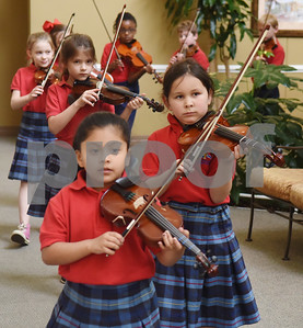 Violin students from St. Gregory Cathedral School play music during lunch at Park Place Nursing & Rehabilitation Center Tuesday Feb. 14, 2017.  (Sarah A. Miller/Tyler Morning Telegraph)